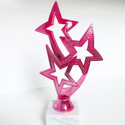Pink award with three stars
