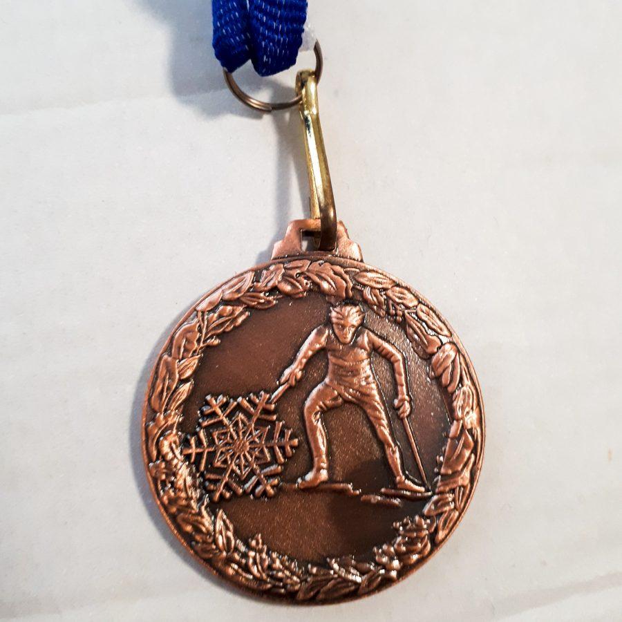 Medalj bronsfärgad med medaljband
